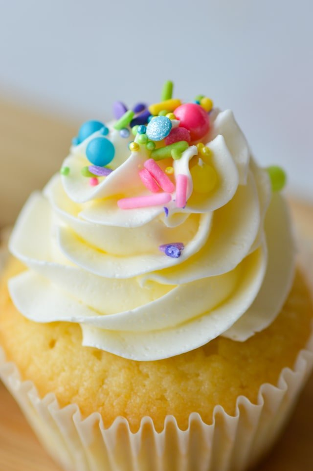 close up of cupcake frosting and sprinkles