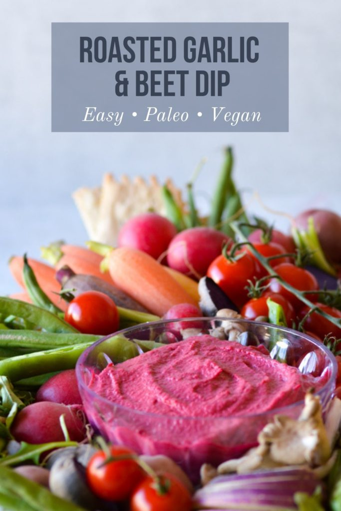 Roasted garlic beet dip with vegetables and text overlay