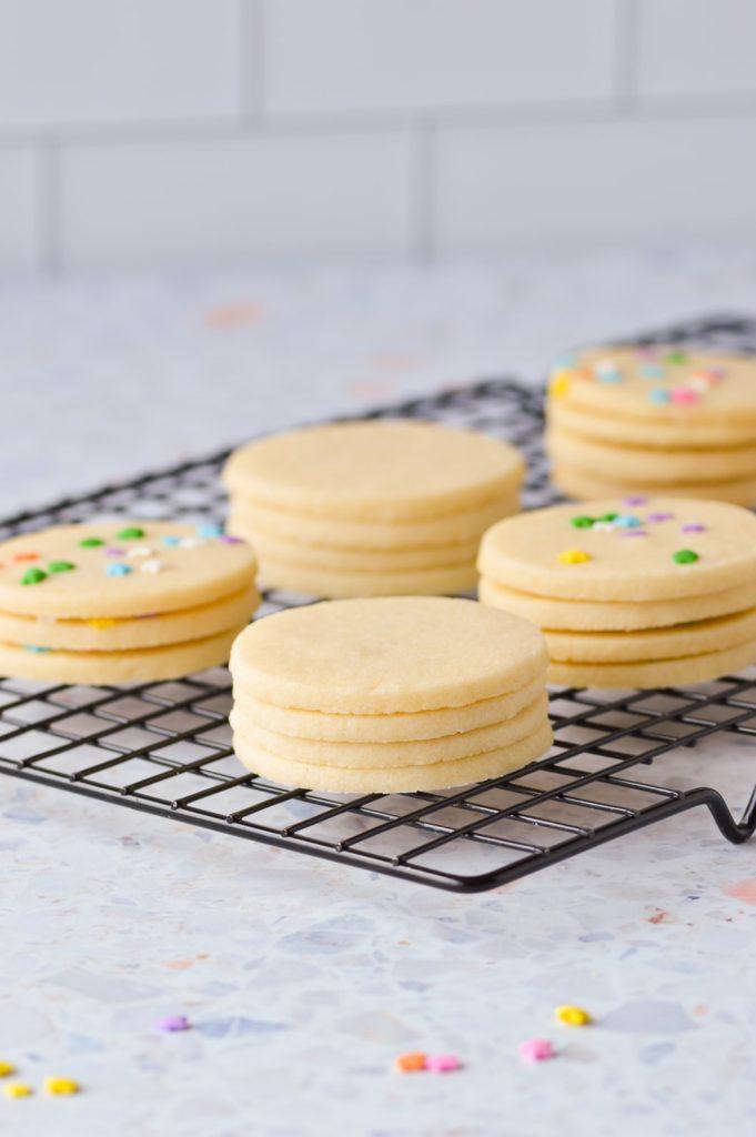 stacked sugar cookies on cooling rack