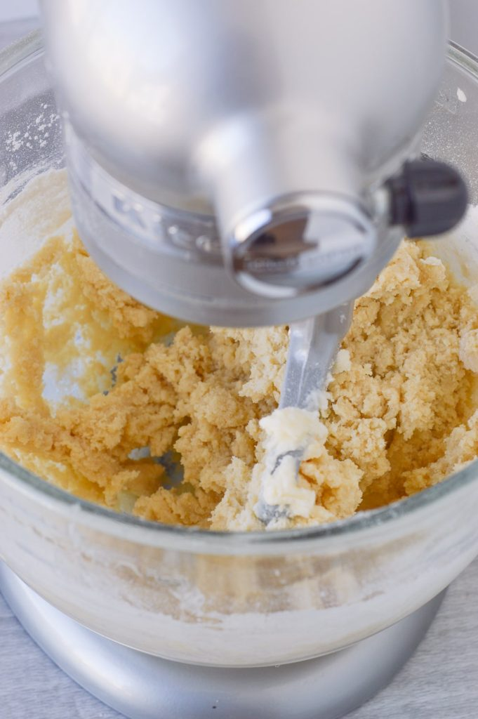 mixing sugar cookie dough in standing mixer