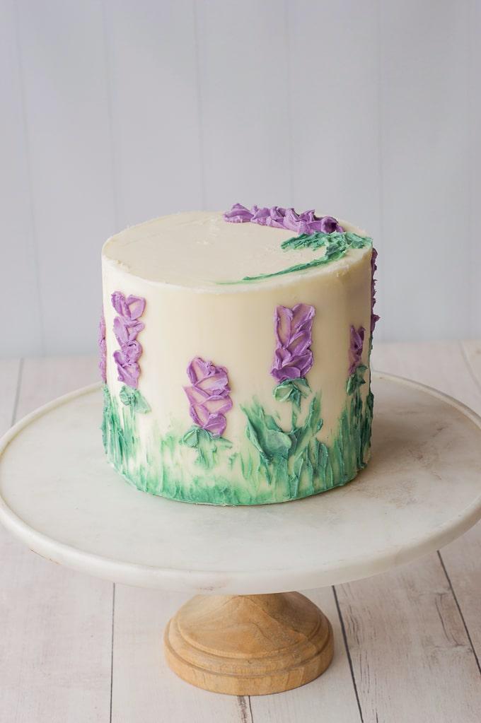 purple flowers painted on cake