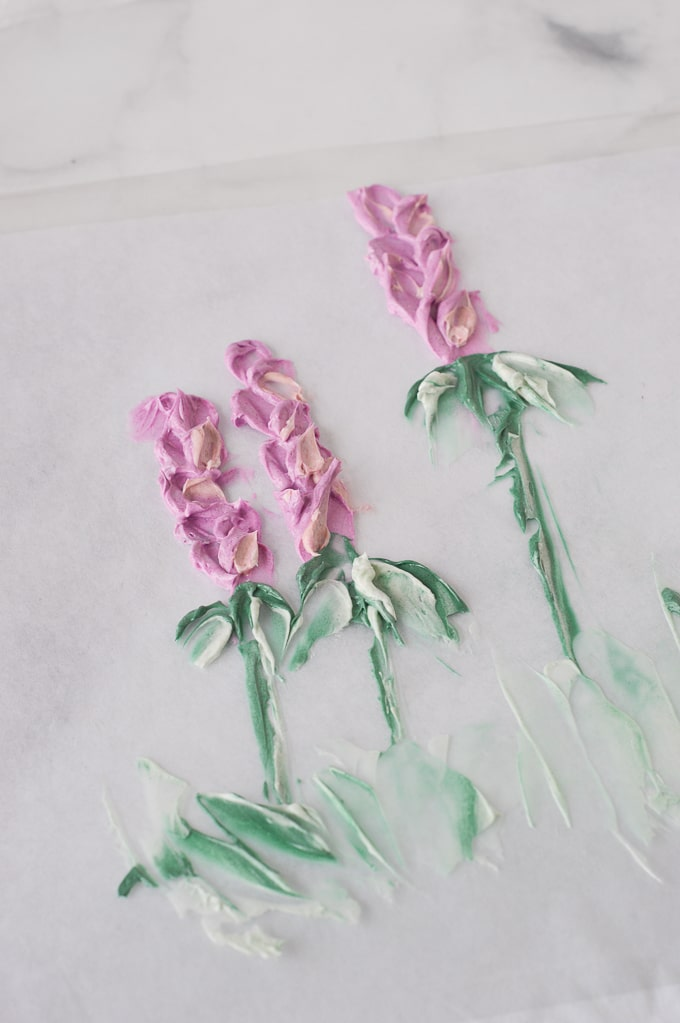purple painted buttercream flowers