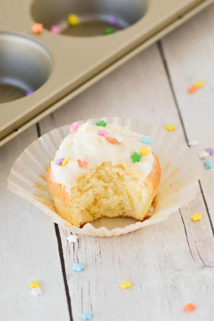 yellow cupcake with bite taken out