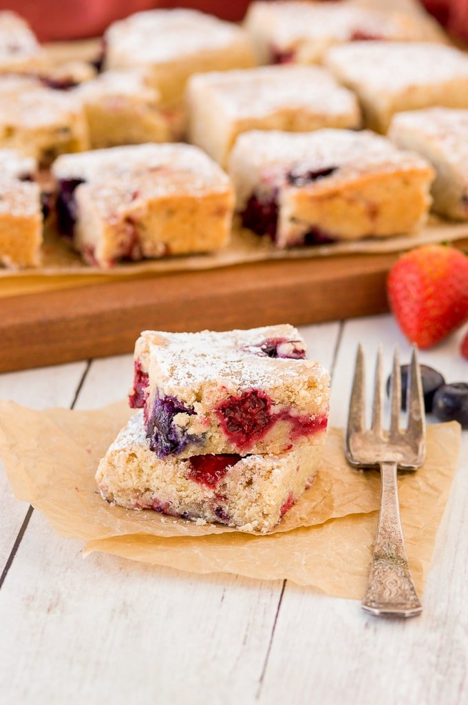 two mixed berry cookie bars with fork