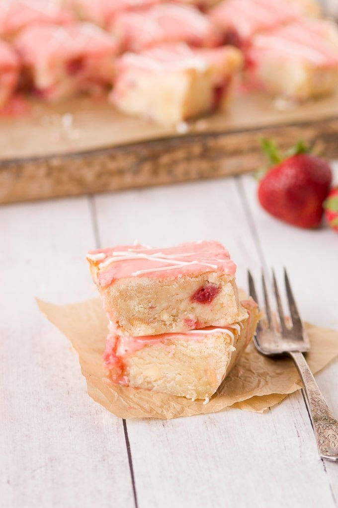strawberry lemon blondies with fork up close