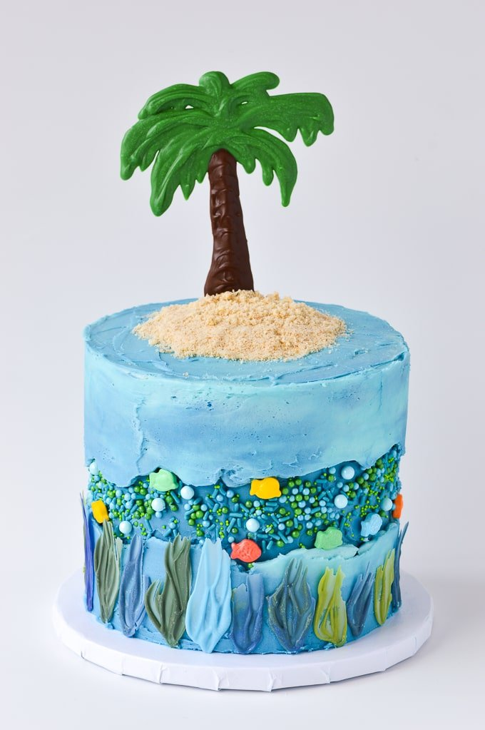 tropic island ocean fault line cake with sprinkle fish