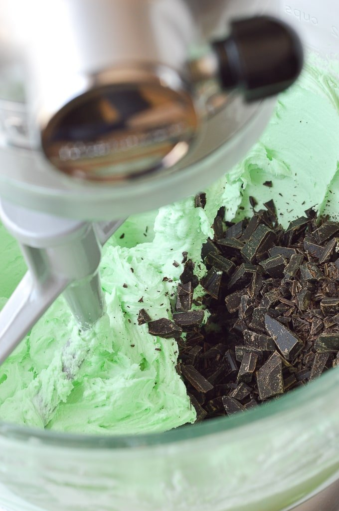 chopped chocolate in bowl of mint buttercream