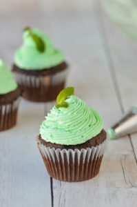 mint frosting piped on chocolate cupcakes