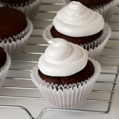 marshmallow frosting piped on cupcakes