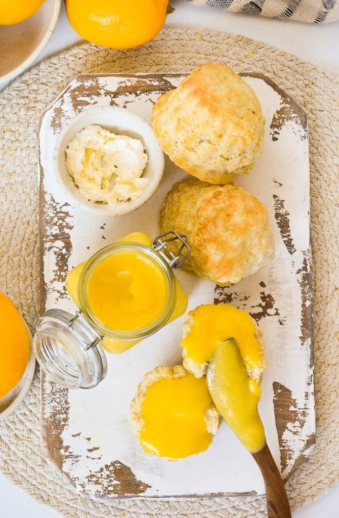 lemon curd in jar with curd on biscuits