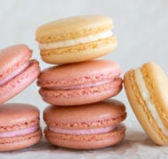 pink and white french macarons up close