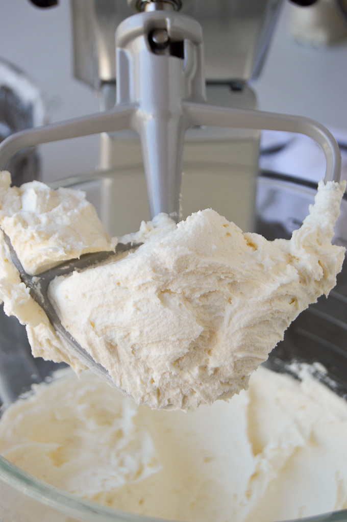 close up of american buttercream frosting on beater