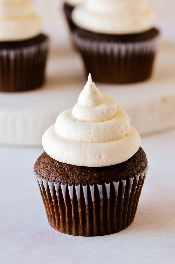 close up of vanilla buttercream on chocolate cupcake