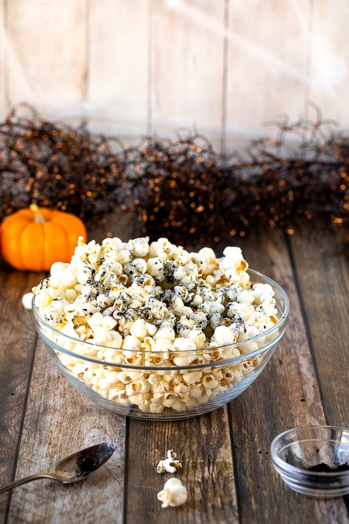 popcorn in bowl with activated charcoal on top