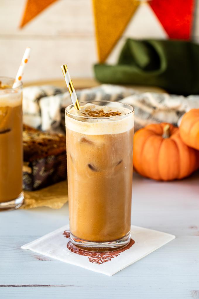 pumpkin cream cold brew in glass with straw