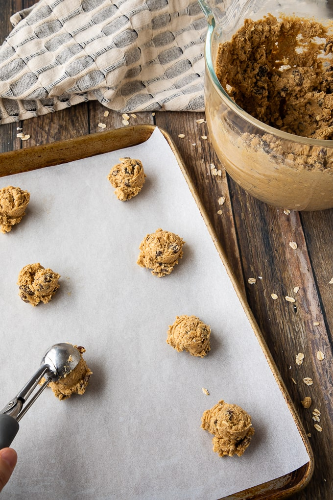 oatmeal cookie dough on parchment baking sheet