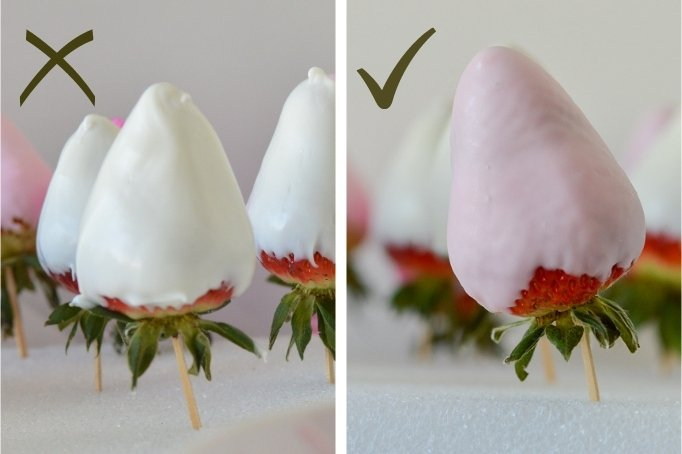 close up of two chocolate strawberries one with drips and one smooth
