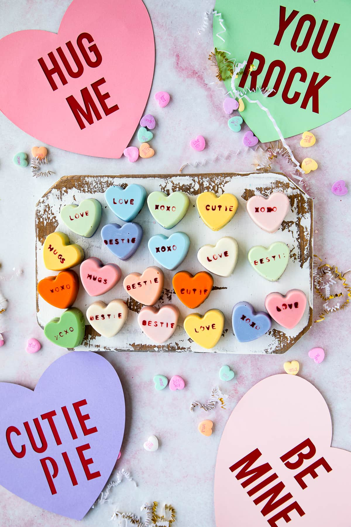 heart cake bites with paper hearts and sweetheart conversation hearts