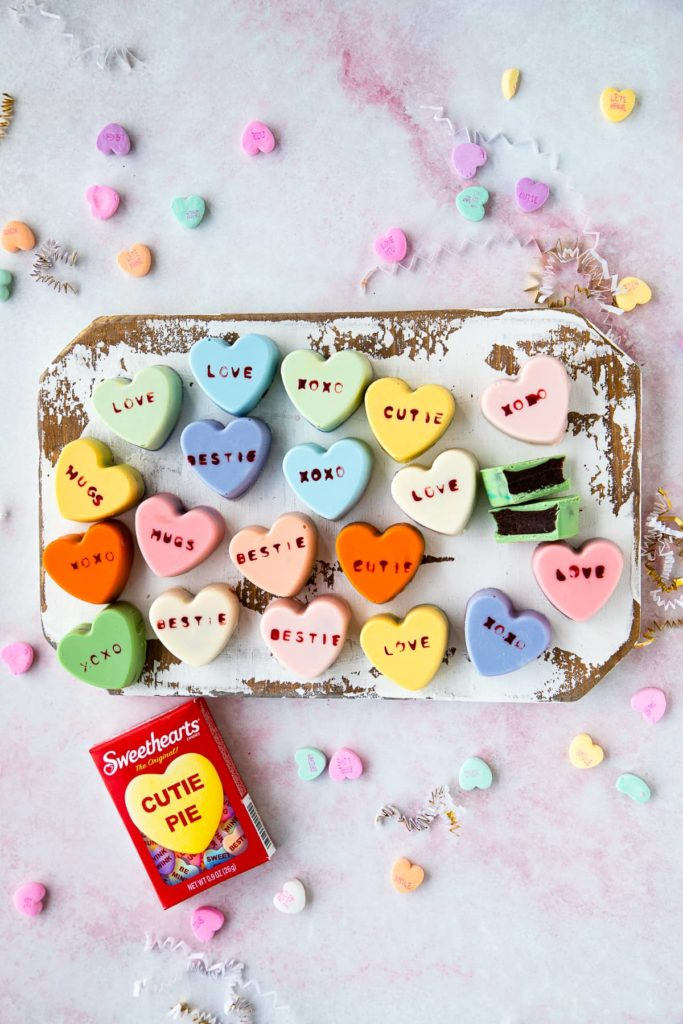 heart cake bites with sweetheart conversation hearts around them