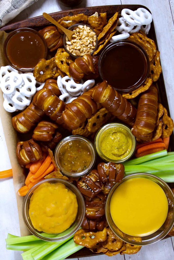 pretzel platter with cheese dip, mustard, and chocolate sauce