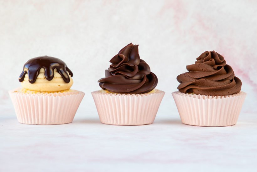 close up of warm, cooled, and whipped ganache on cupcakes