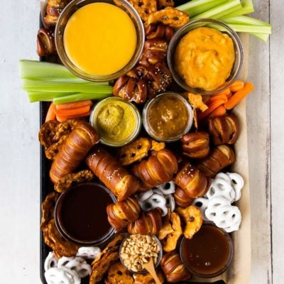 pretzel board with cheese sauce, mustard, and chocoalte