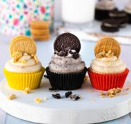 three types of cookies and cream frosting on cupcakes