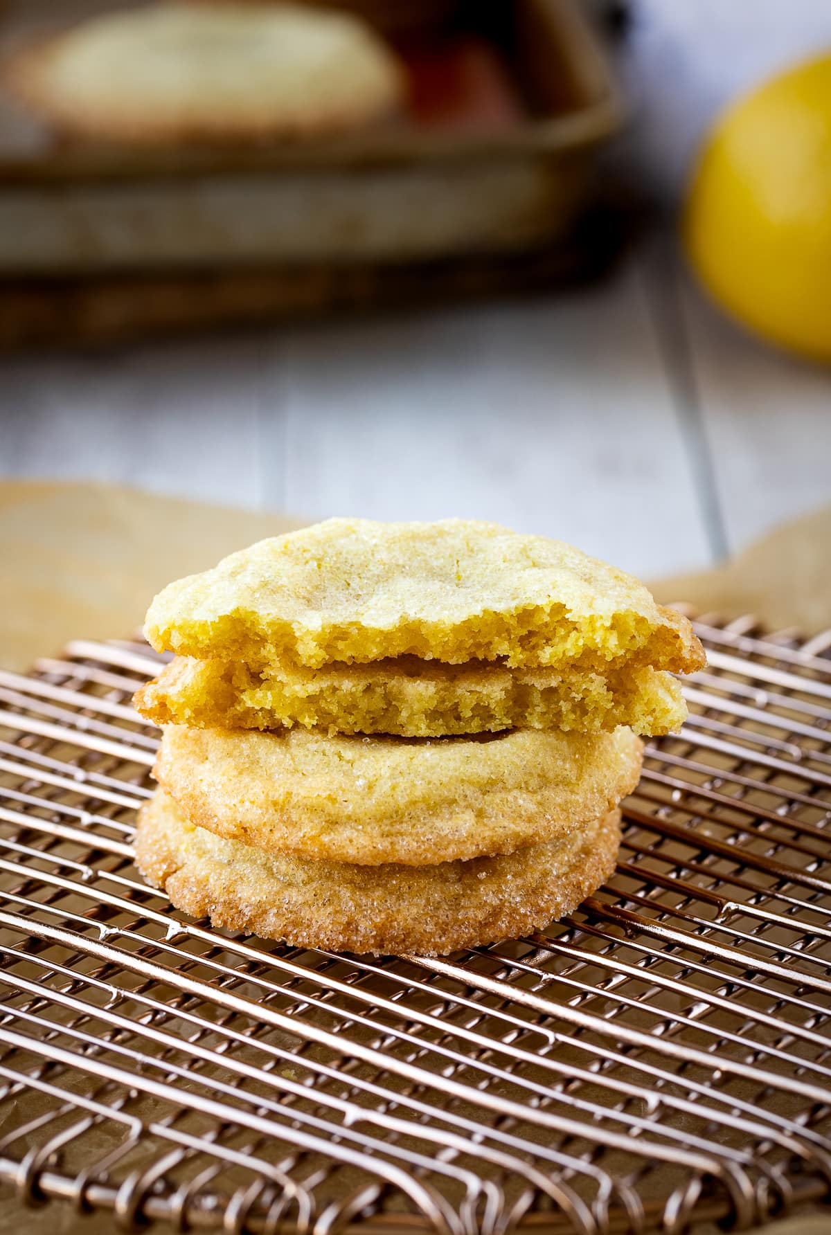 lemon sugar cookies in stack on cooling rack