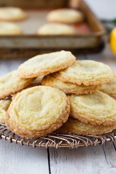 lemon sugar cookies in pile on cooling rack