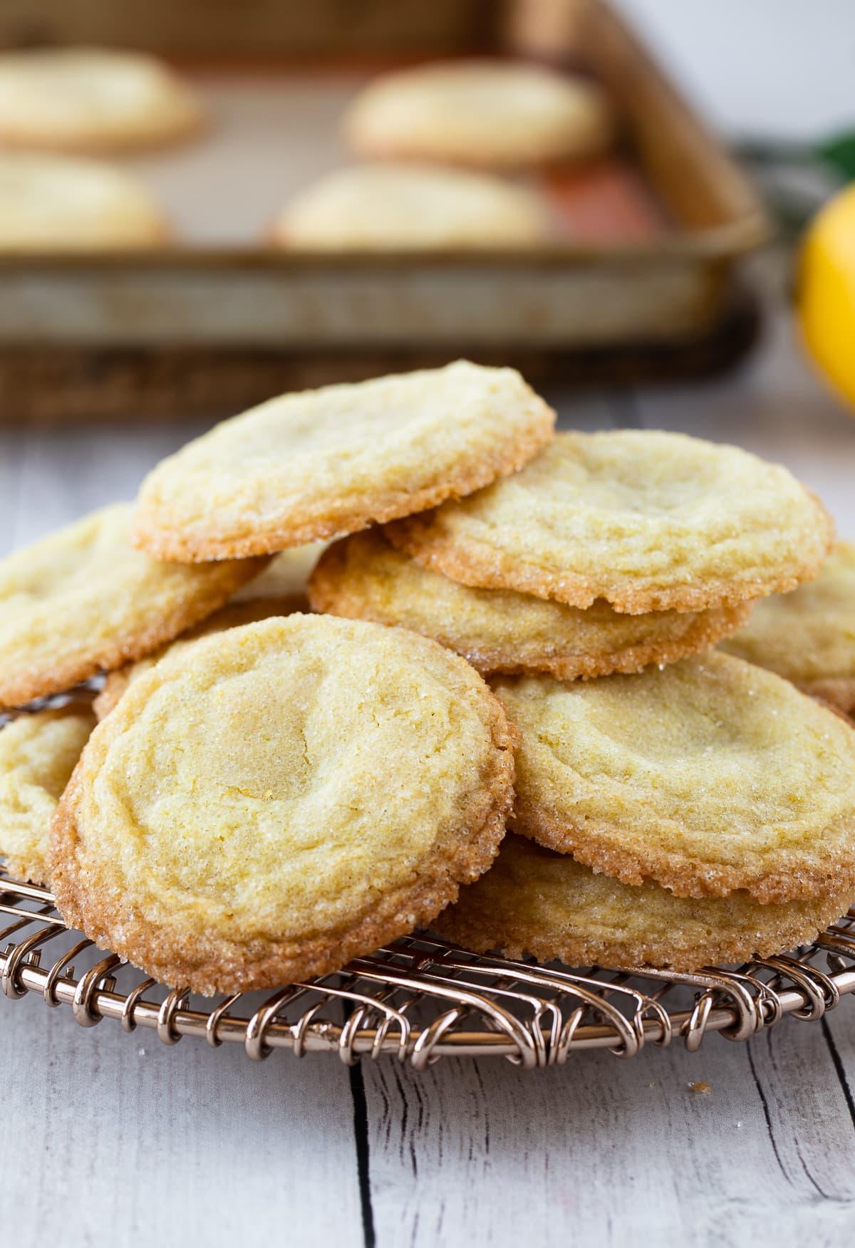 lemon sugar cookies on pile on cooling rack