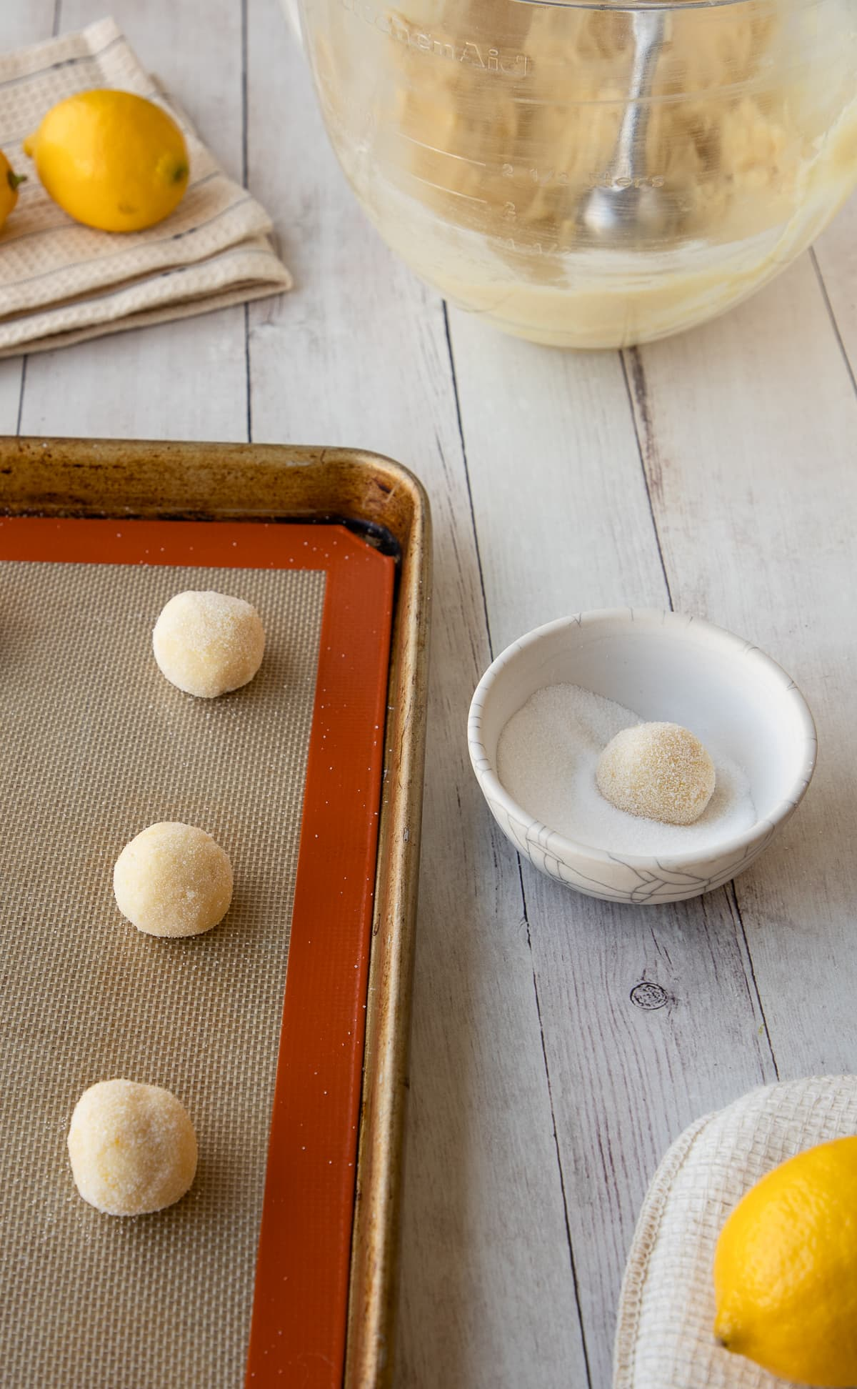 rolling unbaked cookie dough in sugar