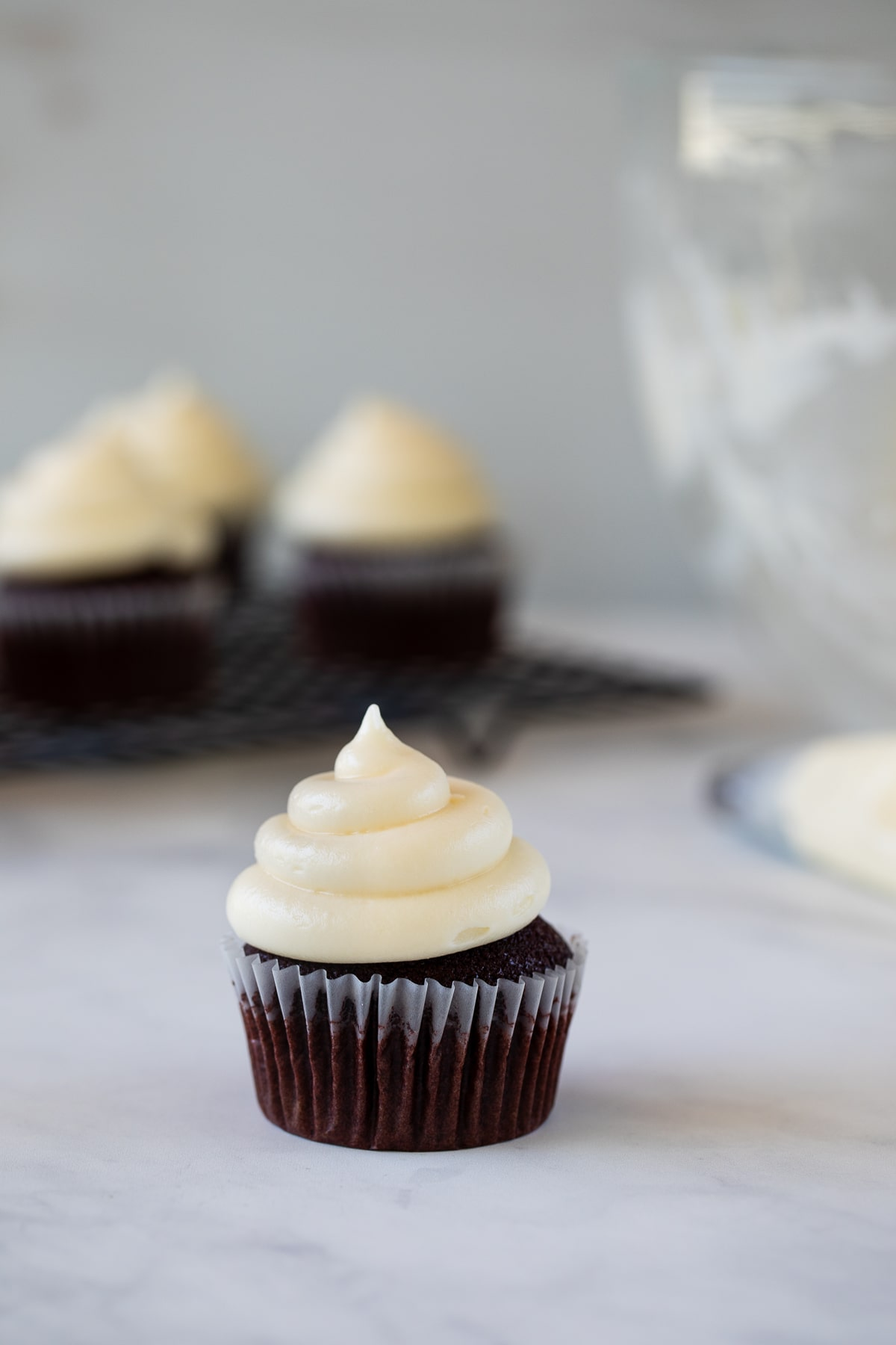 cream cheese frosting piped on cupcake